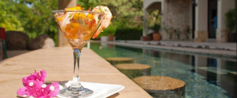 Having drinks by the pool